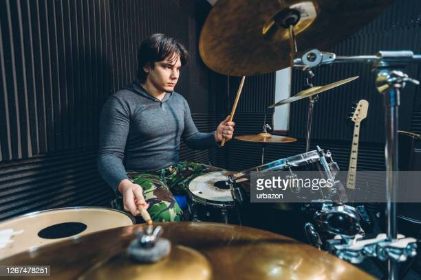 drummer playing drums in studio - modern rock stock pictures, royalty-free photos & images