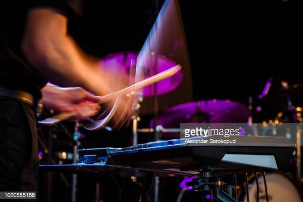 drummer playing rock music on concert - percussion instrument stock photos and pictures