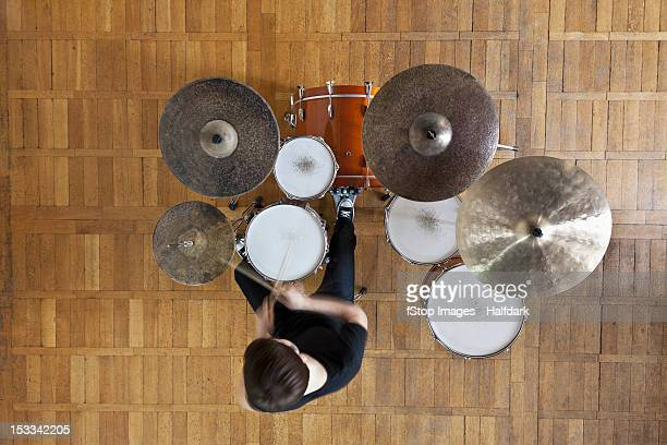 drummer plays kit - drum kit stock pictures, royalty-free photos & images