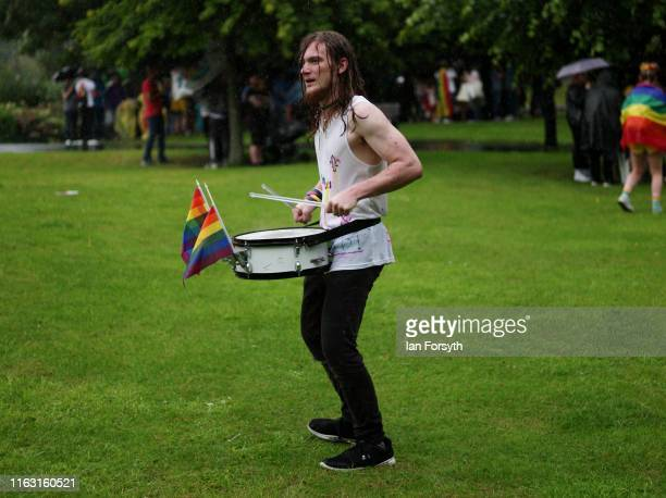 Drummer plays on during a heavy rain shower as he takes part in the Newcastle Pride Festival parade on July 20, 2019 in Newcastle upon Tyne, England....