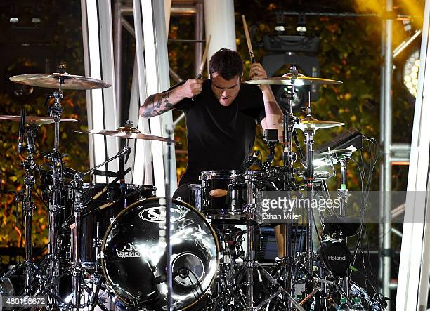 Drummer Rian Dawson of All Time Low performs onstage during the MTV Fandom Fest San Diego ComicCon at PETCO Park on July 9 2015 in San Diego...