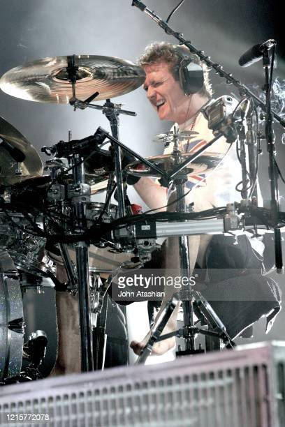 Drummer Rick Allen is shown performing on stage during a live concert appearance with Def Leppard on June 27, 2005.