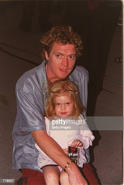 Drummer Rick Allen of the band Def Leppard and daughter Lauren pose for photographers during the induction ceremony at Rock Walk of Fame at Guitar...