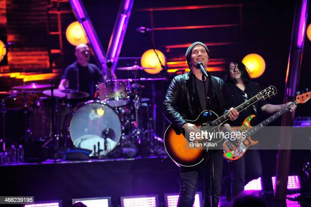 Drummer Rick Woolsterhulme Jr singer Johnny Rzeznik and bassist Robby Takac of the Goo Goo Dolls perform during VH1's 'Super Bowl Blitz Six Nights...