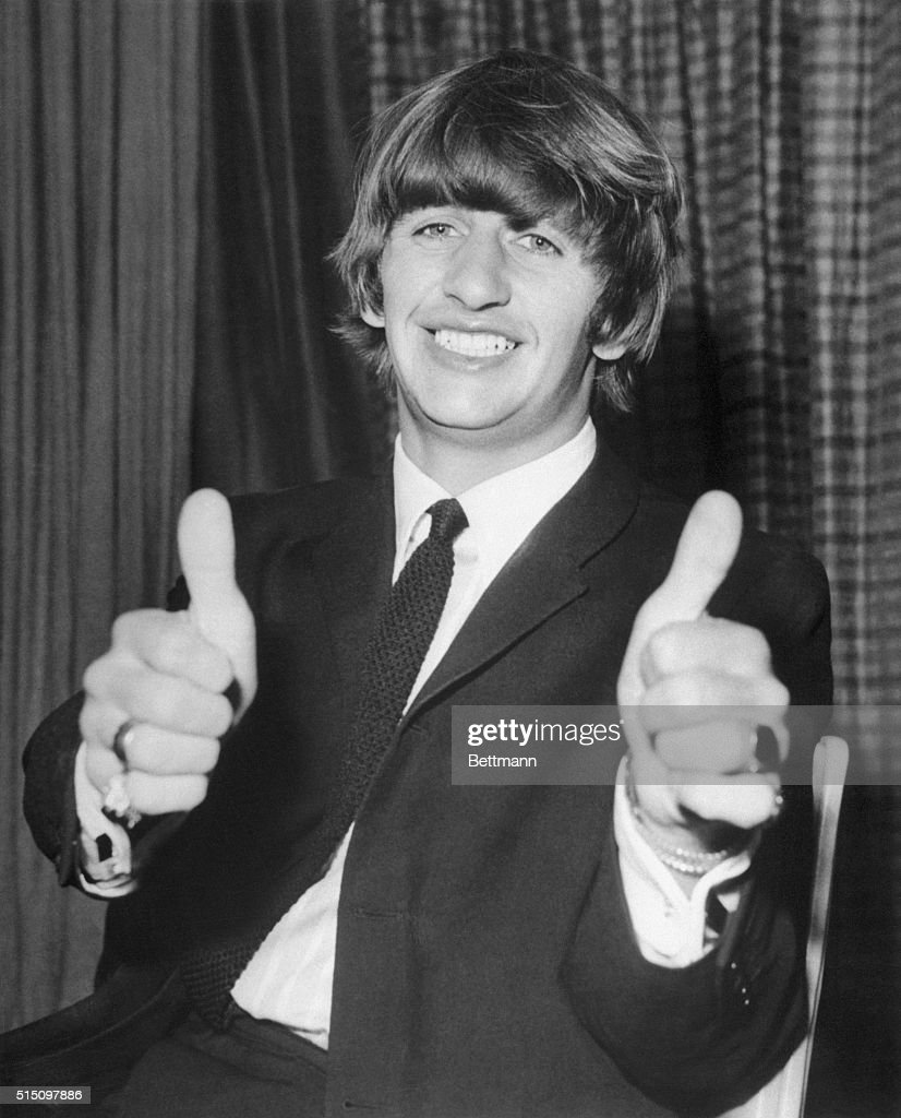 Drummer Ringo Starr Of The Beatles Giving A Thumbs Up Sign Before Leaving Heathrow