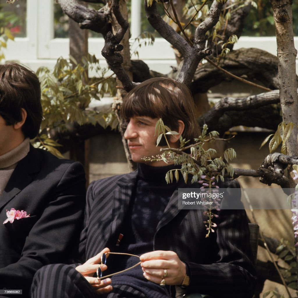 Drummer Ringo Starr of the Beatles in Chiswick House grounds, London, during the making of promotional films for the single 'Rain' and 'Paperback Writer', 20th May 1966. Paul McCartney is sitting to his right.