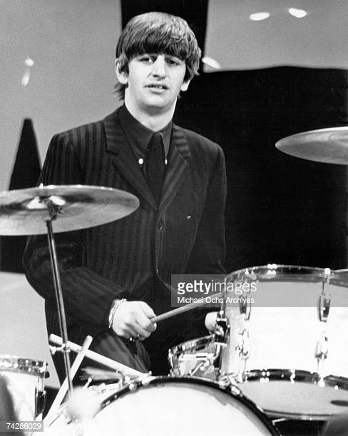 Drummer Ringo Starr of the rock and roll band 'The Beatles' performs onstage in 1964