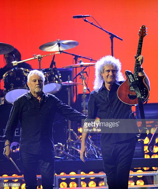 Drummer Roger Taylor and guitarist Brian May of Queen perform during the iHeartRadio Music Festival at the MGM Grand Garden Arena on September 20...