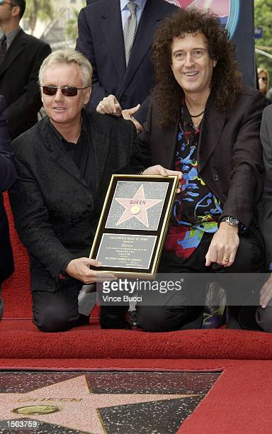 Drummer Roger Taylor and guitarist Brian May of the rock group Queen attend a ceremony honoring the British band with a star on the Hollywood Walk of...