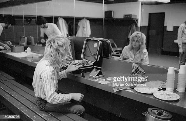 Drummer Roger Taylor of British rock band Queen backstage during the band's US tour January 1977