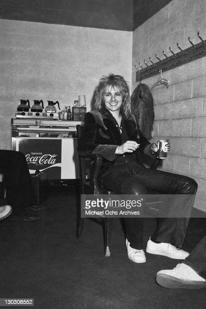 Drummer Roger Taylor of British rock band Queen enjoys the benefits of touring backstage circa 1977