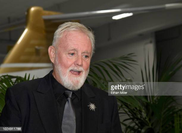 Drummer Roger Taylor of Queen Adam Lambert attends a news conference at the MGM Resorts aviation hangar to kick off the group's 10date limited...
