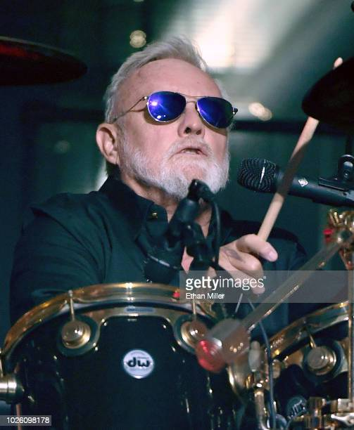 Drummer Roger Taylor of Queen Adam Lambert performs as the group kicks off its 10date limited engagement The Crown Jewels at Park Theater at Park MGM...