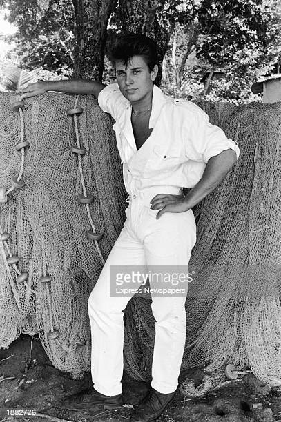 Drummer Roger Taylor of the British pop group Duran Duran posing with some fisherman's nets probably on location for a video shoot for their album...