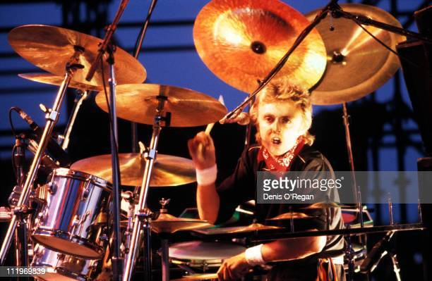 Drummer Roger Taylor performing with British rock group Queen 1982
