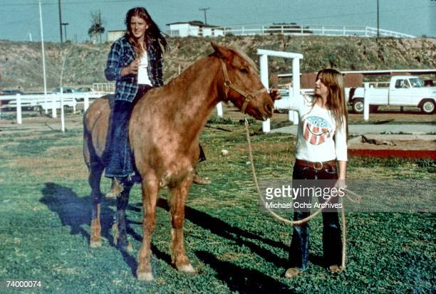 Drummer Sandy West of the rock band 'The Runaways' horseback riding in Los Angeles in December of 1976