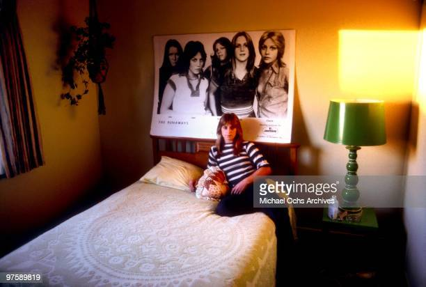 Drummer Sandy West of the rock band 'The Runaways' poses for a portrait in her bedroom at her family's home in Los Angeles California in December 1977