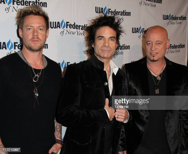 Drummer Scott Underwood singer Pat Monahan and guitarist Jimmy Stafford of Train attend the 2011 UJAFederation of New York's Broadcast Cable and...