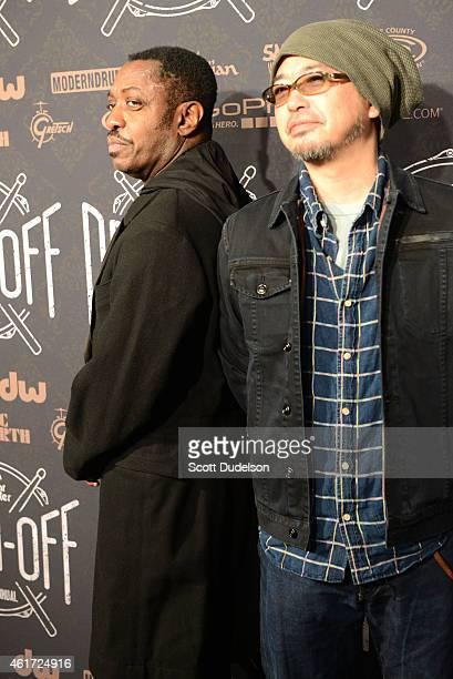 Drummer Steve Jordan and guitarist Tamio Okuda walk the red carpet at Club Nokia on January 17, 2015 in Los Angeles, California.