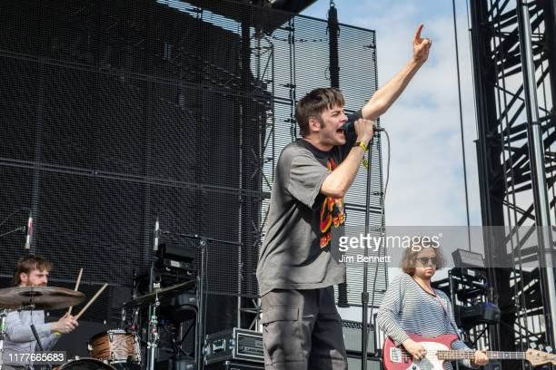 Drummer Tom Coll, lead vocalist Grian Chatten and bassist Conor Deegan III of Fontaines D.C. Perform live on stage during Ohana Festival at Doheny...