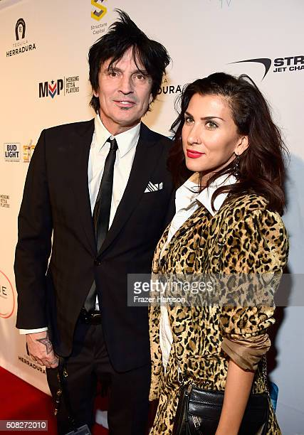 Drummer Tommy Lee and Sofia Toufa attend Glazer Palooza and Suits and Sneakers on February 3 2016 in San Francisco California