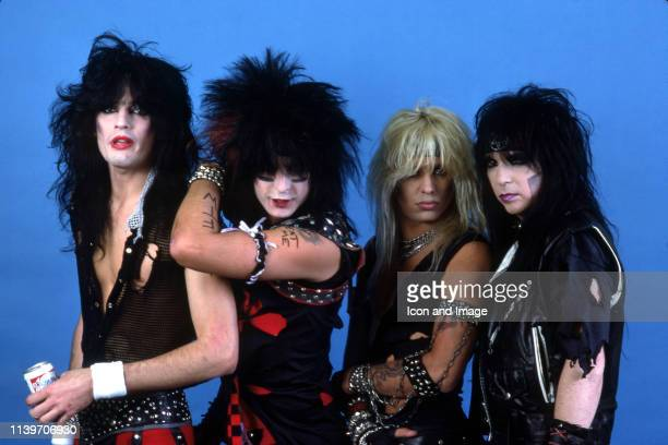 Drummer Tommy Lee bass player Nikki Sixx lead singer Vince Neil and lead guitar player Mick Mars who together form the heavy metal band Mötley Crüe...