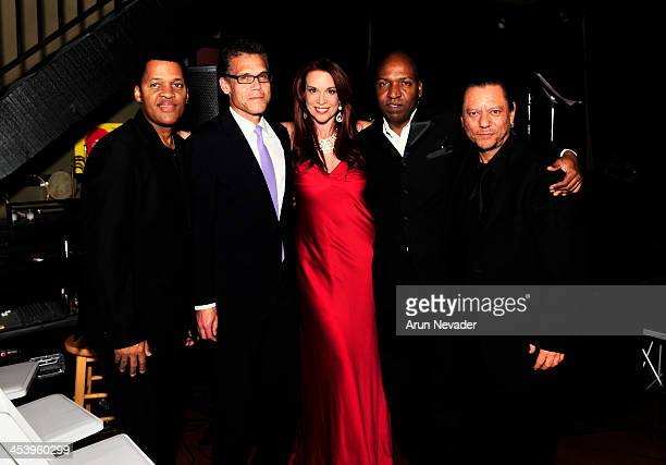 Drummer Tony Moore guitarist Mark Hammond singer/actor Chase Masterson Bassist Del Atkins and pianist Leon Bisquera attend the A Swingin' Christmas...