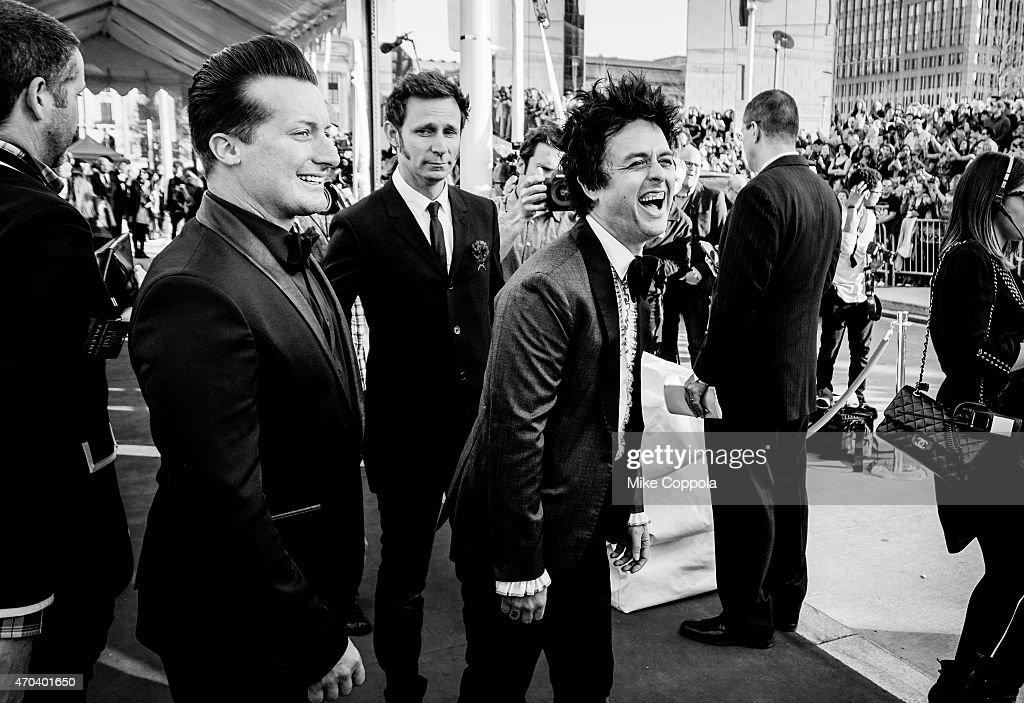 Drummer Tré Cool , bass player Mike Dirnt, and singer Billie Joe Armstrong of the band Green Day attend the 30th Annual Rock And Roll Hall Of Fame Induction Ceremony at Public Hall on April 18, 2015 in Cleveland, Ohio.