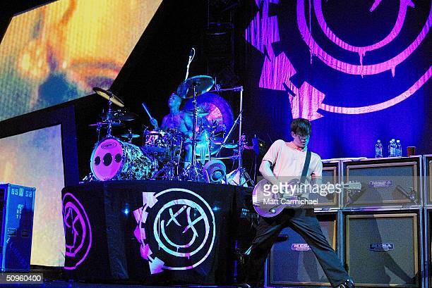 Drummer Travis Barker and guitarist Tom Delonge of Blink 182 perform as part of their current coheadlining tour with No Doubt at the Tweeter Center...