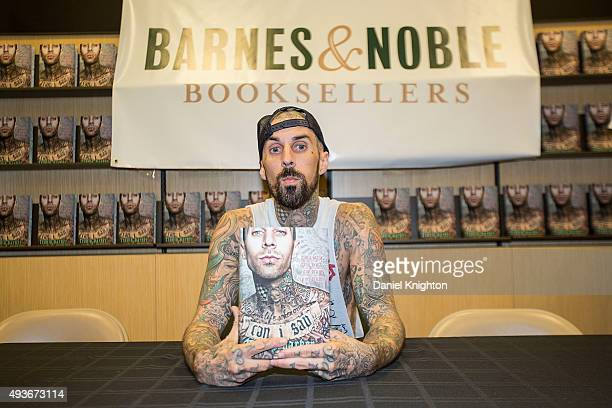 Drummer Travis Barker of Blink182 appears at an autograph signing for his book 'Can I Say Living Large Cheating Death And Drums Drums Drums' at...