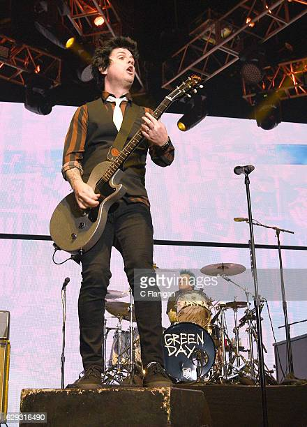 Drummer Tre Cool and Billie Joe Armstrong of Green Day perform during the 2016 KROQ Almost Acoustic Christmas at The Forum on December 11 2016 in...