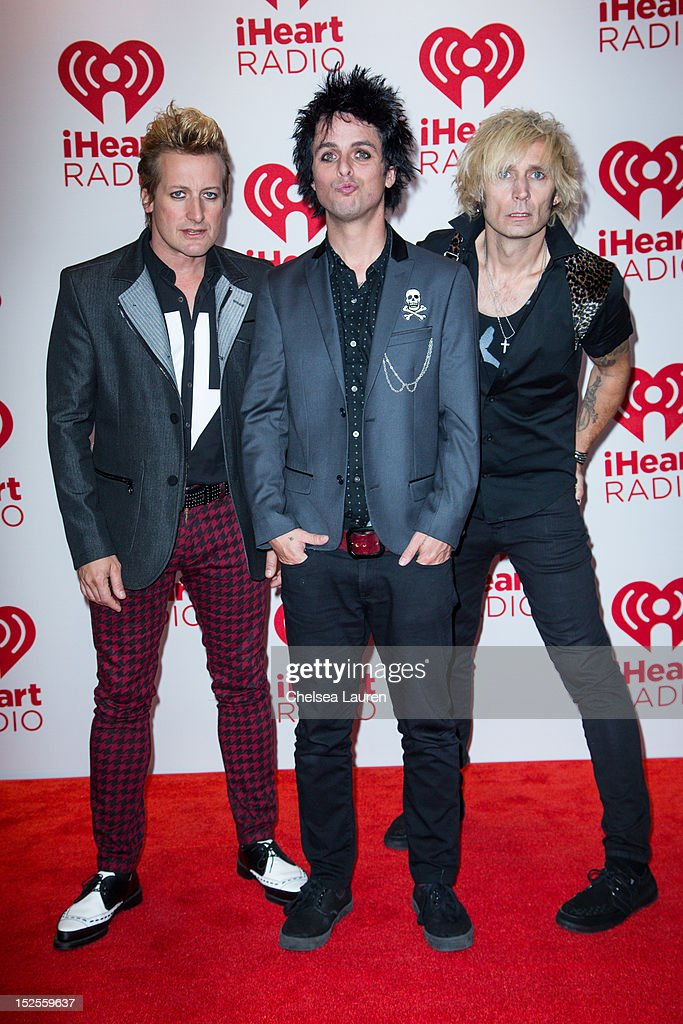 Drummer Tre Cool, vocalist Billie Joe Armstrong and bassist Mike Dirnt of Green Day arrive at iHeartRadio Music Festival press room at MGM Grand Garden Arena on September 21, 2012 in Las Vegas, Nevada.