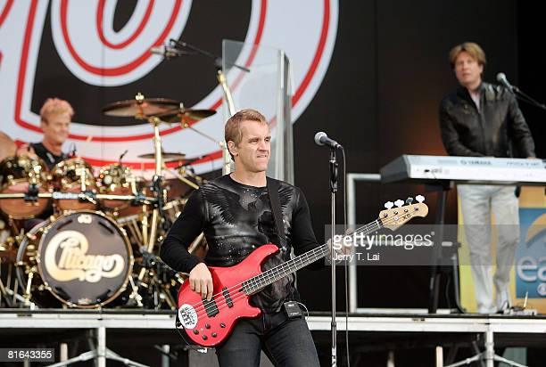 Drummer Tris Lmboden bassist Jason Scheff and keyboard player Bill Champlin perform on CBS' 'The Early Show' at Charter One Pavilion on June 20 2008...