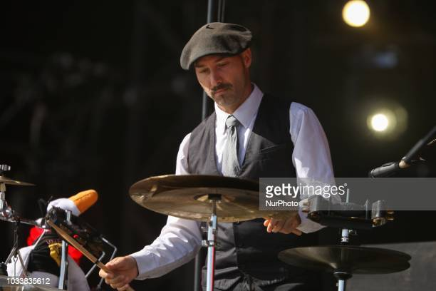 Drummer/backing vocalist Phil Jourdain from the French band Inspector Cluzo performs on stage during the Festival of Humanity a political event and...