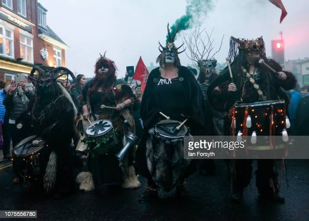 Drummers accompany participants as they parade through the streets during the annual Whitby Krampus parade on December 01 2018 in Whitby England The...