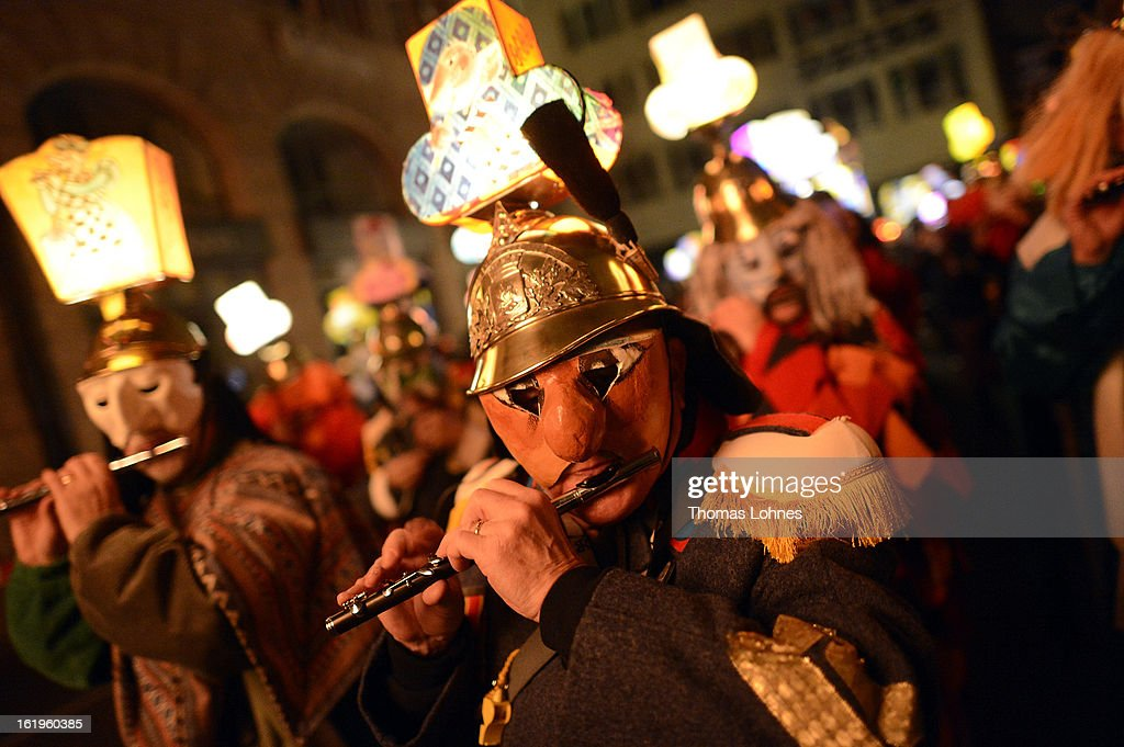 Drummers and pipers with typical masks and lanterns take part in the traditional 'Morgestraich' for the opening of the Basel Fasnacht Carnival on February 18, 2013 in Basel, Switzerland. More than 12,000 participants will take part in the largest carnival in Switzerland that lasts for 72 hours and will be watched by more than 100,000 spectators as it makes its way through the city center.