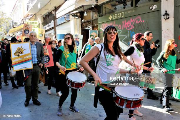 Drummers are seen performing before the protesters during a protest calling for increased efforts to stop climate change