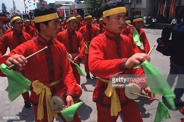 Drummers celebrate the 120th anniversary of the arrival of Hennessy Cognac in China