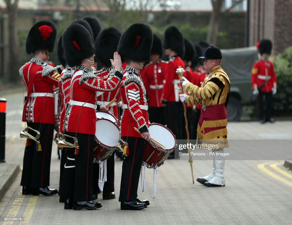 Drummers from the Corps of Drums of the Coldstream Guards make last minute touches to their uniform before joining soldiers from the 1st Battalion Coldstream Guards to be inspected by Major General Ben Bathurst at Victoria Barracks in Windsor, Berkshire, in preparation for Trooping the Colour.