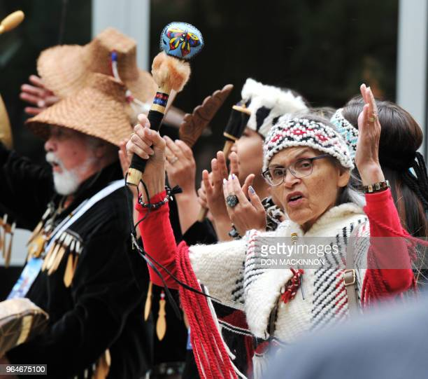 Drummers from the Squamish Lil' wat Cultural Centre lead delegates of G7 Finance Ministers and Central Bank Governors conference to the opening...