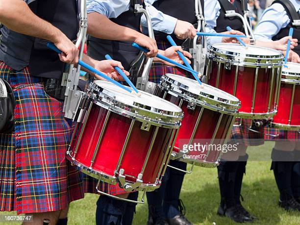 drummers in a scottish pipe band - kilt stock photos and pictures