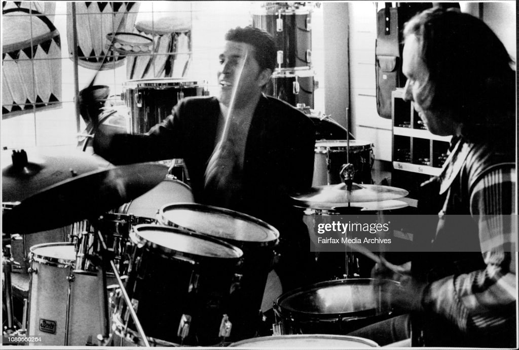 Drummers Paul Joseph and Yianni Mano warm up in preparation for