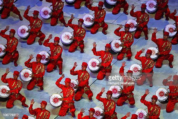 Drummers perform during the Opening Ceremony for the 16th Asian Games Guangzhou 2010 at Haixinsha Square on November 12 2010 in Guangzhou China