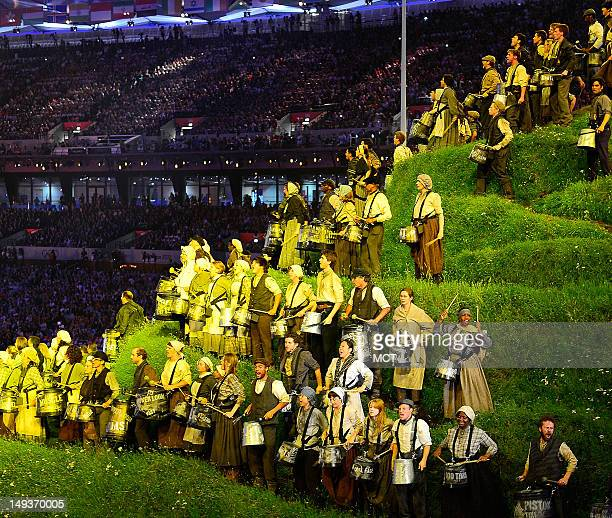 Drummers perform on a hill during the Opening Ceremony at the Olympic Stadium in London, England, during the 2012 Summer Olympic Games, Friday, July...