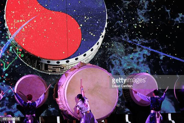 Drummers perform the traditional Korean Drum welcome during the opening ceremony of the 2015 Presidents Cup at the Convensia Ceremony Hall on October...