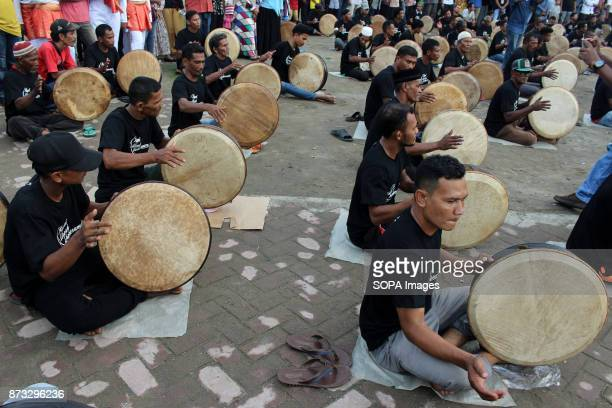 LHOKSEUMAWE ACEH INDONESIA Drumpers seen participating in the event A total of 430 people played the art of 'Rapai Urouh' at Iraq Square...