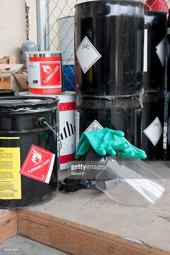 Drums and containers of poisonous and flammable substances : Stock Photo