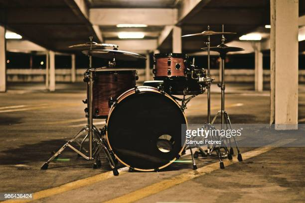 drums in a parking garage - drum kit stock photos and pictures
