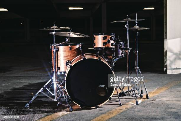 drums in a parking garage - drum kit stock pictures, royalty-free photos & images