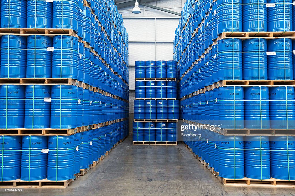 Drums of dairy products stand stacked at Synlait Milk Ltd.'s manufacturing plant in the town of Rakaia, 60km from Christchurch, New Zealand, on Friday, Aug. 30, 2013. Synlait, a unit of Shanghai-based Bright Dairy & Food Co., will process more milk than forecast in 2013-14, the company announced on Aug. 30. Photographer: Brendon O'Hagan/Bloomberg via Getty Images